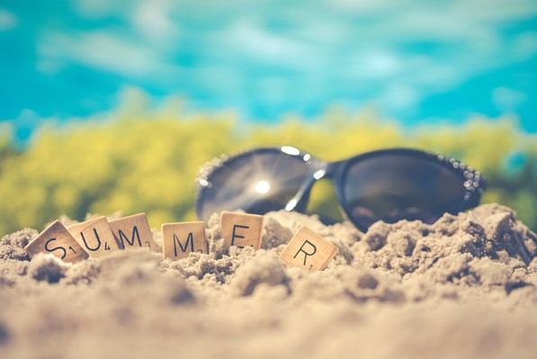 macro-photography-of-black-sunglasses-on-sand-1209610